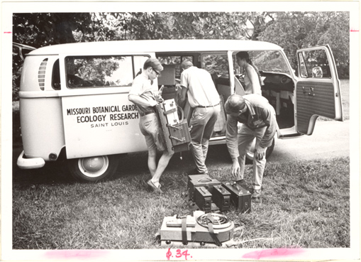 Image of Research.  Michigan.  Hyrum Johnson and Sylvia Morhardt packing ecology wagon to go to Michigan.  Mounted with PHO 2007-0078.