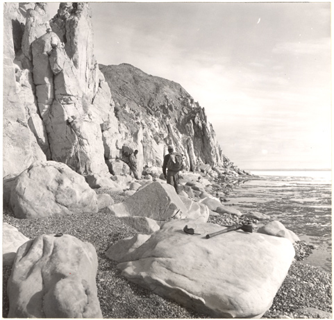Image of Sandstone cliffs along the lake made precarious walking and at one spot we were forced to wade the icy water for half mail.  Lake Hazen, Ellsemere Island.  Cover, Vol. 50, Ap[ril 1964.