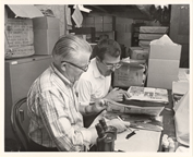 Image of Dr. John Dwyer & Dr. Tom Croat examine Herb. Spec.