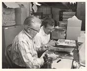 Image of Dr. John Dwyer & Dr. Tom Croat examine Herb. Spec.