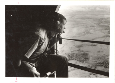 Image of Dr. Walter Lewis in USAF helicopter.  Negative available at PHO 2007-0231.  Mounted with PHO 2007-0233 and PHO 2007-0234.
