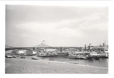 Image of St. Louis Riverfront.  Huck Finn riverboat, Eads Bridge.