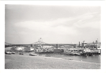 Image of St. Louis Riverfront.  Huck Finn riverboat, Eads Bridge.