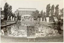 Image of Entering the Victory Garden Harvest Show, Oct. 2-4, 1942.  Palm House and Lily pool.  Mounted with PHO 2007-1501.  Negative available at PHO 2007-1502.