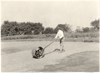 Image of Garden staff planting bent grass.  Bulletin Vol. 16.  Mounted with PHO 2007-1766, PHO 2007-1767, and PHO 2007-1768.
