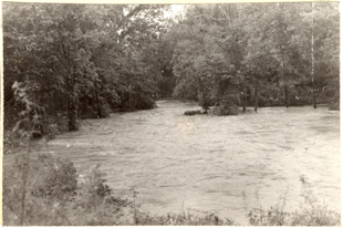 Image of Flood in Brush Creek, East Bridge.  Mounted with PHO 2007-1907, PHO 2007-1908, and PHO 2007-1909.  Bulletin, Vol. 32, May 1944.