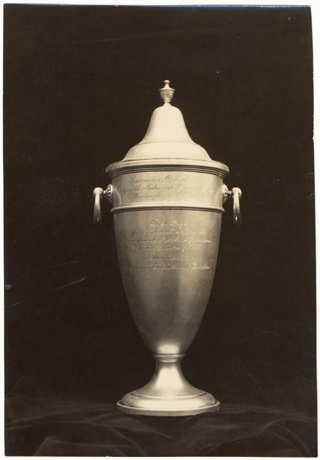 Image of Mrs. F.E. Dixon silver cup awarded to the Missouri Botanical Garden for exhibit illustrating the development of orchids from seeed to the mature plant.  October 16-18, 1930.  Bull 18(8):137 (Oct. 1930)