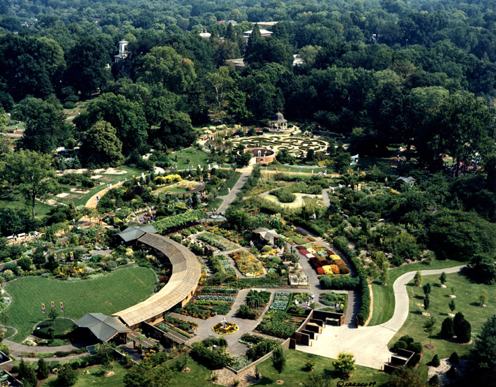 Image of Aerial view showing Kemper Home Gardening Center and Blanke Boxwood Garden in background. View is looking to the east.
