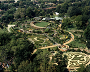 Image of Aerial view showing Kemper Home Gardening Center and Blanke Boxwood Garden in background. View is looking to the west.