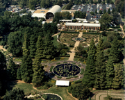 Image of Aerial view showing lily pools, Gladney Rose Garden, Linnean House, and Ridgway Center. View is looking to the north.
