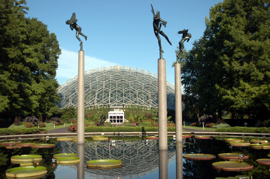 Image of View of exterior of Climatron with view of  lily pools and sculptures in summer.