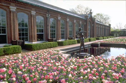 Image of Linnean House front showing plantings, pools, and sculpture.