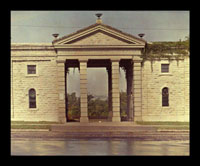 Image of Front view of the original Main Gate from across Tower Grove Ave.  Color magic lantern slide.