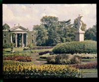 Image of Parterre view with Juno in the foreground to the right c.1900.  Main Gate visible in the background.  Image taken from color magic lantern slide.  Note on (original) jacket 'Main Gate 724' in color.