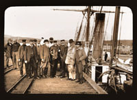 Image of Harriman party on boat dock in Alaska.  Harriman Alaska Expedition, 1899.  Curtis, photographer.
