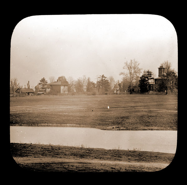 Image of North American Tract gradings. Shows farm buildings, Tower Grove House, Museum Building, and mausoleum in background.