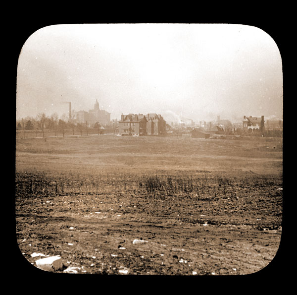 Image of North American Tract ungraded.  Houses and Mental Hospital visible in background.  View is to the west.