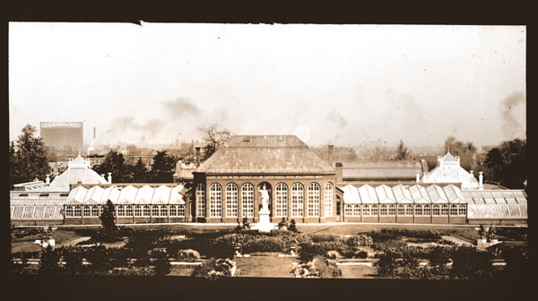 Image of View of Main Conservatory (1868-1916) with Juno in the foreground.  Pollution and storage tank are visible in the background.