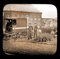 Image of People in front of the Main Conservatory (1868-1916) after flower show with horse drawn ambulance.  Tent is visible to the right.  See also PML 1980-0399 with same title and date.