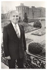 Image of Dr. Peter Raven standing on the rear porch of Tower Grove House.